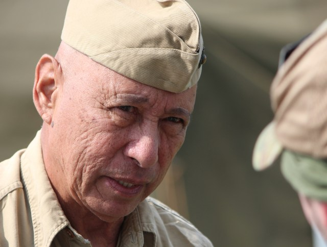 Dave Robles, 76, of Beaufort, S.C., wears a World Warr II-era uniform while reenacting as a forward control member with Marine Fighting Squadron 115, a Corsair squadron that served in the Pacific. Robles served 31 years in the U.S. Marine Corps, and he has been involved in reenacting for about 12 years. This was his first time participating in the Warbirds Over the Beach air show. [John-Henry Doucette/The Princess Anne Independent News]