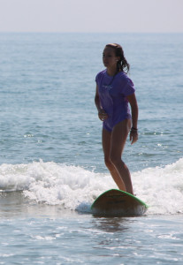 Alyssa Stanford surfing at Sandbridge. [John-Henry Doucette/The Princess Anne Independent News]