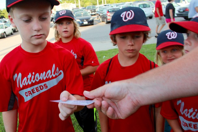 Silas Hoggard gets his ticket for the Norfolk Tides game at Harbor Park from one of the coaches. With him are Brady Saar, Dylan Joyner and Leah Gentry. [John-Henry Doucette/The Princess Anne Independent News]