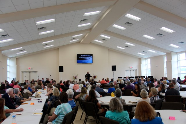 The Rev. Chuck Moseley, pastor of Oak Grove Baptist Church, delivers a sermon during a special service in the church's new multipurpose building in July. [John-Henry Doucette/The Princess Anne Independent News]