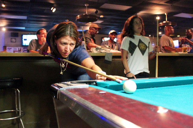 Jennifer Giampa of Aragona lines up a shot early in the Friday night pool tournament at Mike's Break Room in the Landstown area. [John-Henry Doucette/The Princess Anne Independent News]