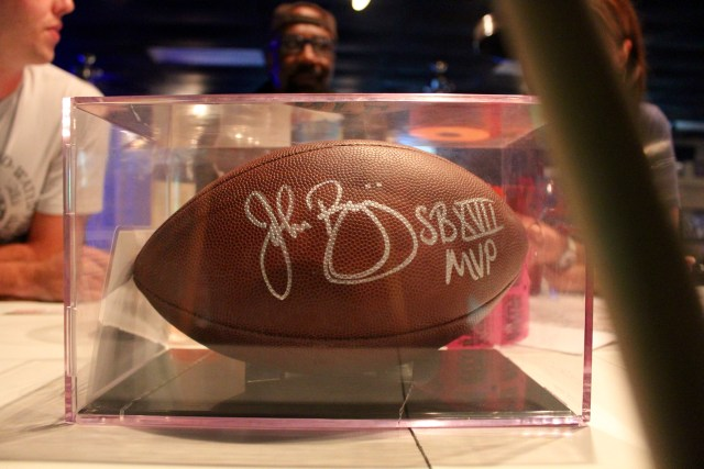 This football autographed by John Riggins is being auctioned off for charity at Mike's Pool Room until the first week of the season. [The Princess Anne Independent News]