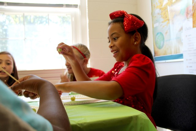 Kriscilla Robinson, 9, assembles a healthy snack during a Girl Empowerment Camp held at St. John's Baptist Church. [John-Henry Doucette/The Princess Anne Independent News]