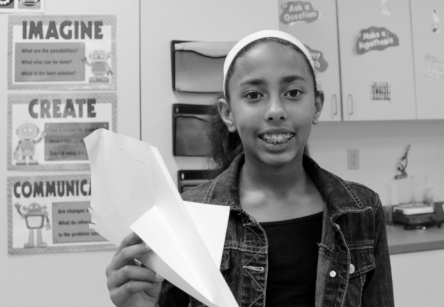 "Zariah Betts, 11, of Blackwater shows off her aircraft. It was meant to go slow. ""I threw it, and it was actually really slow,"" she said. [John-Henry Doucette/The Princess Anne Independent News]"