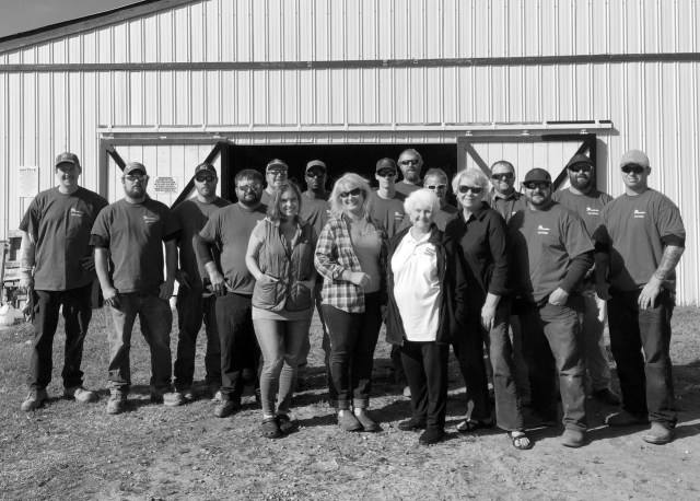 Volunteers from Dominion Power stand in front of the barn they began to paint with Lynn Bukowski and her family. [Courtesy photo/Bonita Billingsley Harris/Dominion Power]
