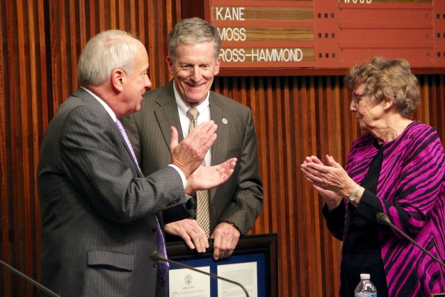 Virginia Beach Mayor Will Sessoms and City Councilmember Barbara Henley applaud City Manager Jim Spore during a meeting on Tuesday, Dec. 8, at City Hall. It was Spore's last meeting as manager, a position he has held for 24 years.  [John-Henry Doucette/The Princess Anne Independent News]