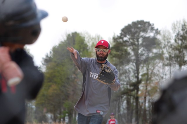Derrick Howell, a coach of the Tidewater Titans, pitches during a game at the baseball field on his property in Blackwater in April. [John-Henry Doucette/The Princess Anne Independent News]