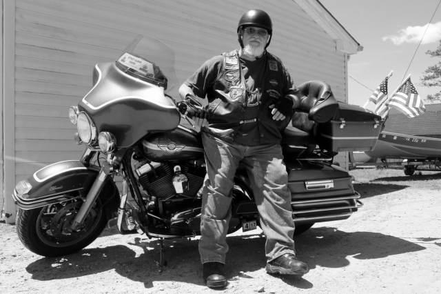 "Paul ""Bear"" Angel is seen at West Neck Marina with his 2003 Electra Glide Classic Anniversary Edition, which he uses in rides to commemorate fallen members of the armed forces. [John-Henry Doucette/The Princess Anne Independent News]"