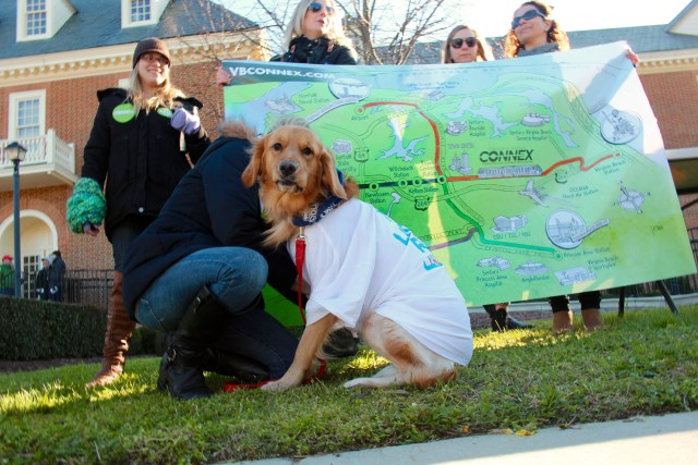 Advocates for light rail, with a dog keeping them company, hold a Virginia Beach Connex sign during a rally at City Hall in April. [John-Henry Doucette/The Princess Anne Independent News]