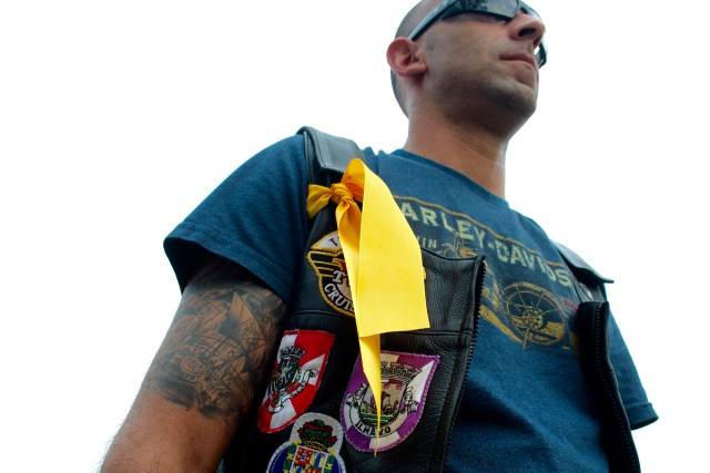 "Bruno ""Gypsy"" DoAmoral of the Tidewater chapter of the V-Twin Cruisers Motorcycle Club wears a yellow ribbon to remember a friend, Nick Garza of Texas. [John-Henry Doucette/The Princess Anne Independent News]"