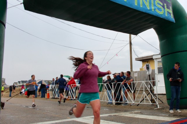 Holly Moye, 20, of Holland Pines, had a big smile on her face when she crossed the finish line. [John-Henry Doucette/The Princess Anne Independent News]