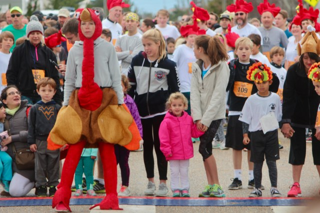 Runners at the starting line during Charlie Normile's Turkey Trot Race for the Fallen on Thursday, Nov. 24, in Sandbridge. [John-Henry Doucette/The Princess Anne Independent News]
