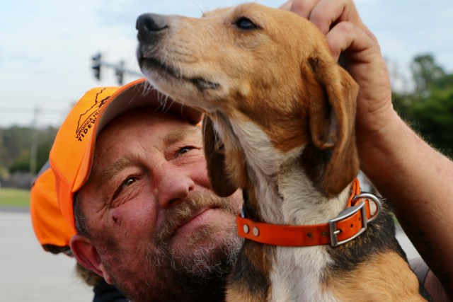 Hunters, with dogs in tow, deliver a kind bounty to rescue personnel