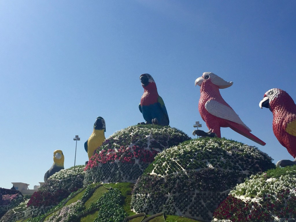 Over size birds covered in petals.
