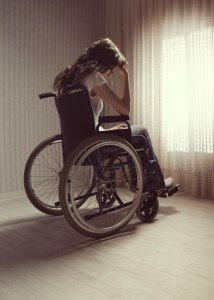 Crying Woman Sitting In Wheelchair