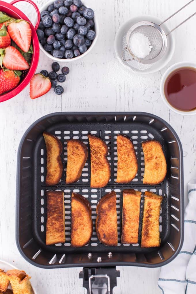 Air Fryer French Toast Sticks cooked in the air fryer