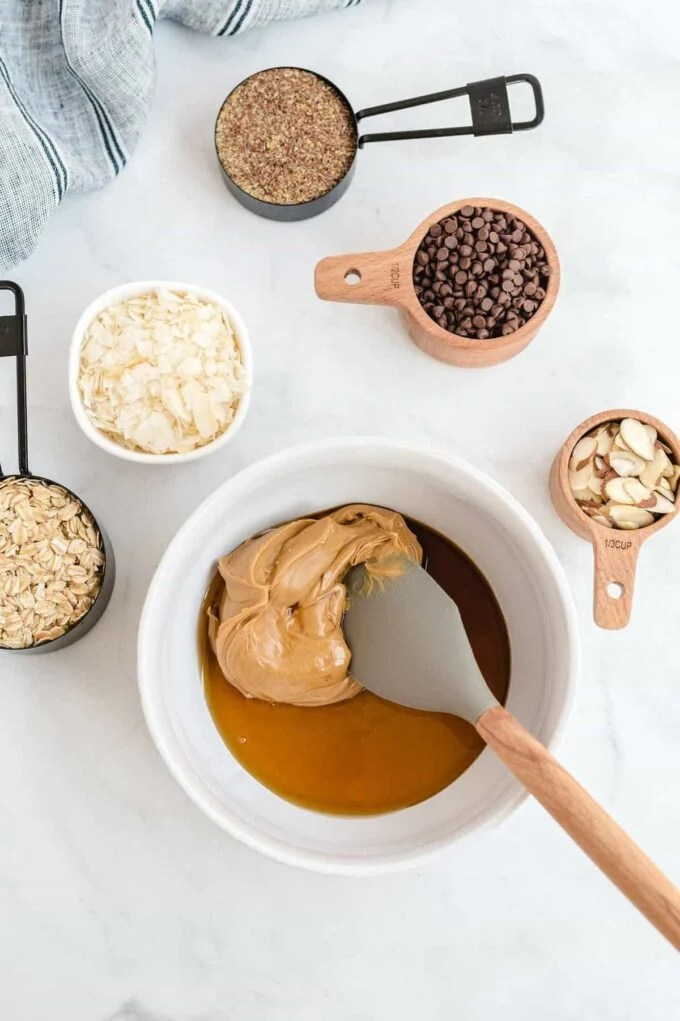 Peanut butter, honey and vanilla extract in a mixing bowl