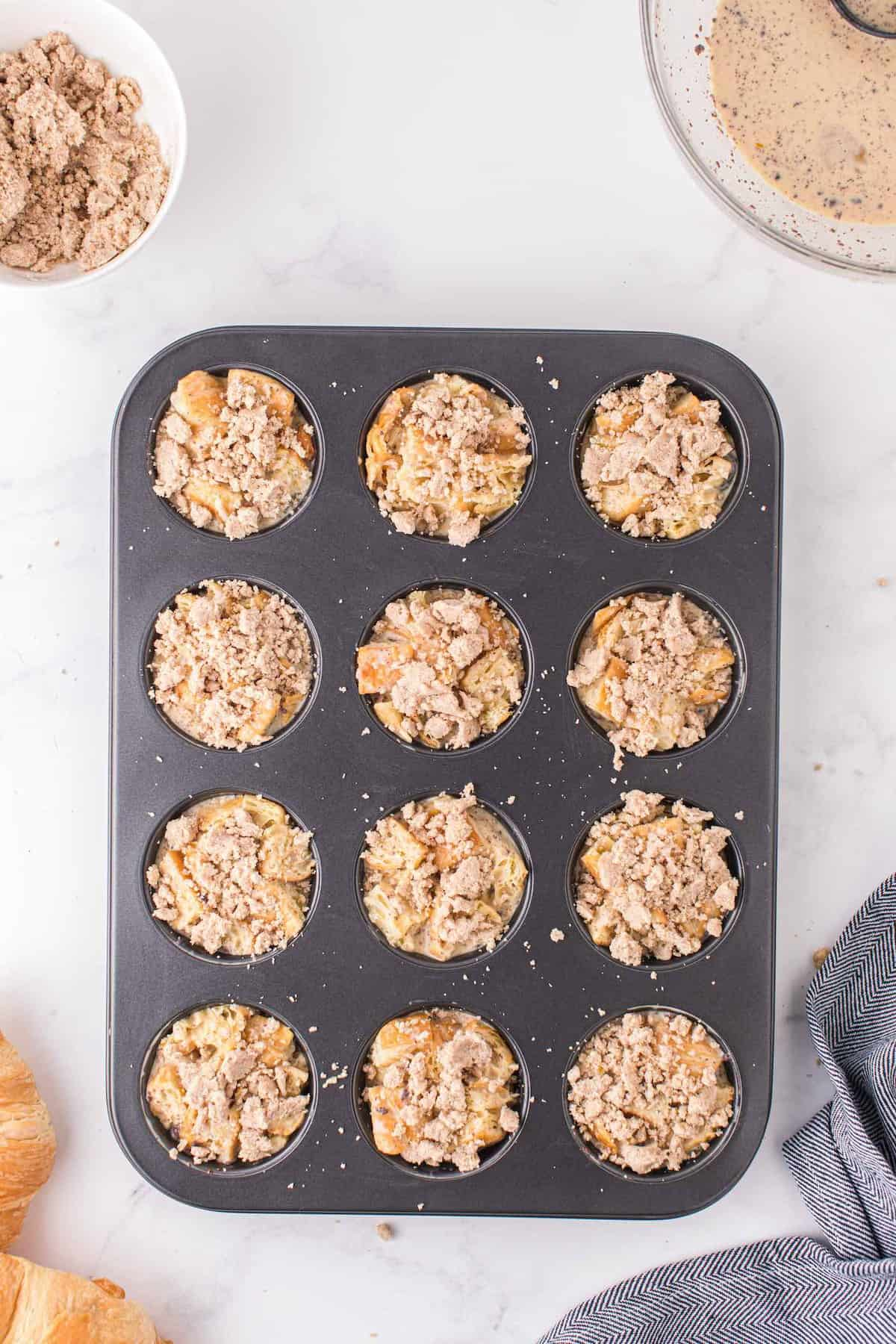 Sprinkle the crumble mixture on each muffin