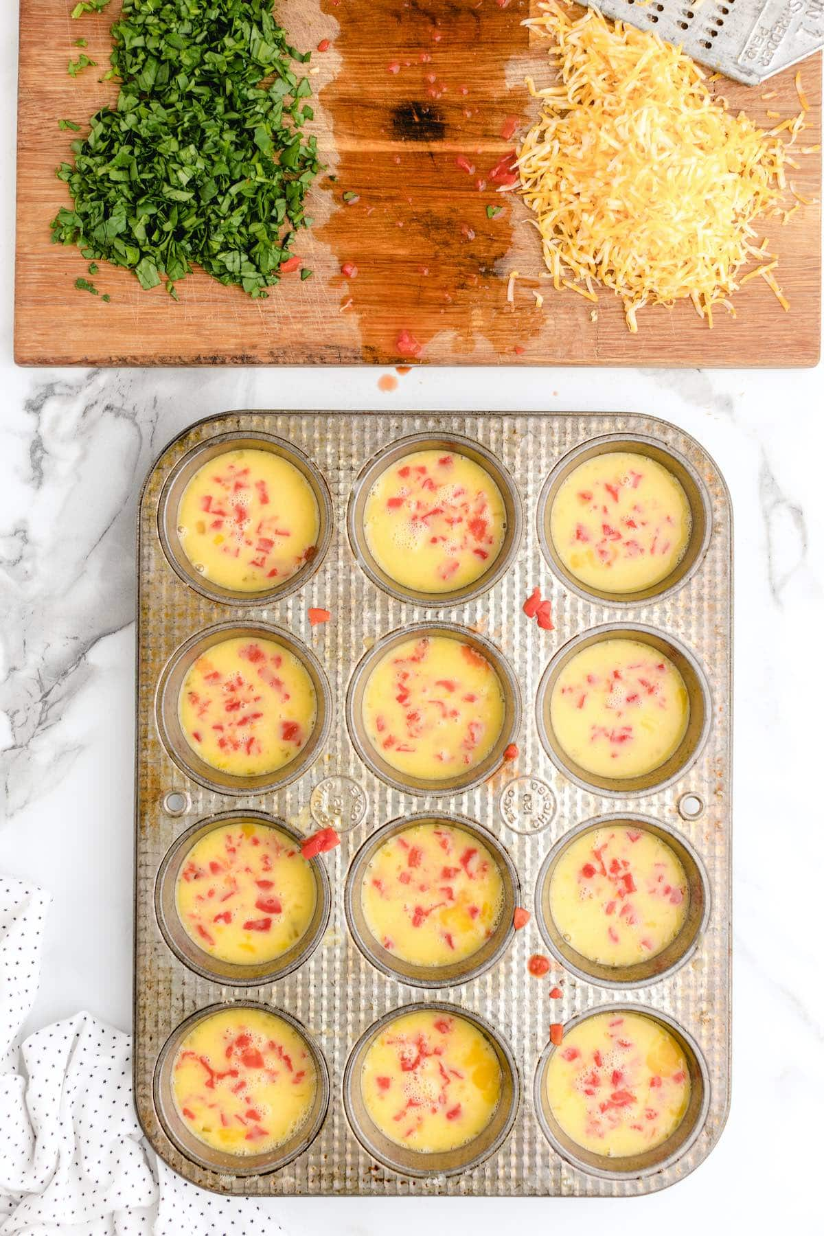 add red bell peppers in each muffin stain
