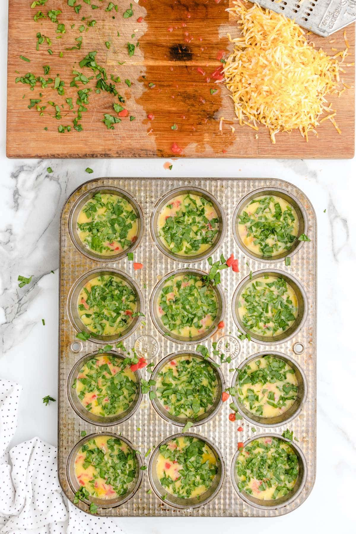 Add spinach to each muffin stain