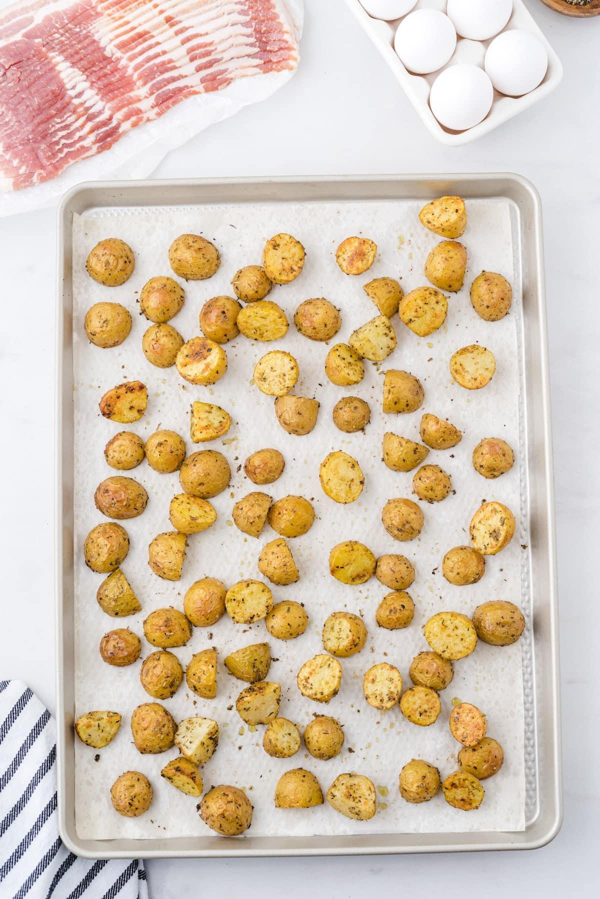 Spread the potatoes in the baking dish