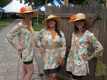 Julie, Vanessa, and Deidre model the women's Tentucky Derby costume.