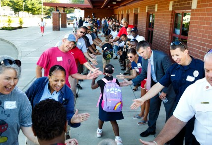 Students starting their first day at Matheny-Withrow School were greeted by smiles and high-fives from parents, teachers, emergency responders, city officials and community partner organizations Monday, Aug. 22, 2016. Rich Saal/The State Journal-Register
