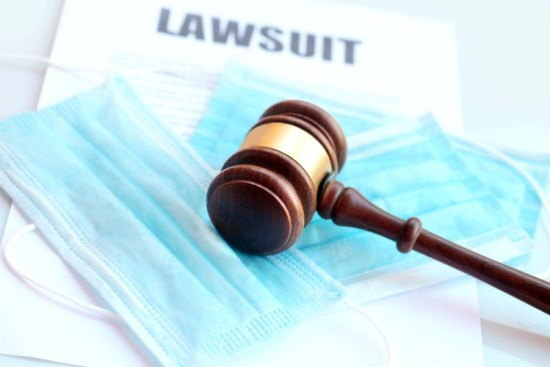 Huge Lawsuits Coming Against COVID Fraudsters Covid-lawsuit-image-Maicai-Stock-Getty-Images-Plus