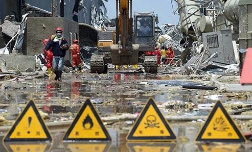 Firefighters clear hazardous chemicals at a solar panel factory in China after tornado strike.