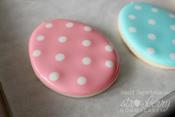 Add polka-dots to the cookies with white royal icing