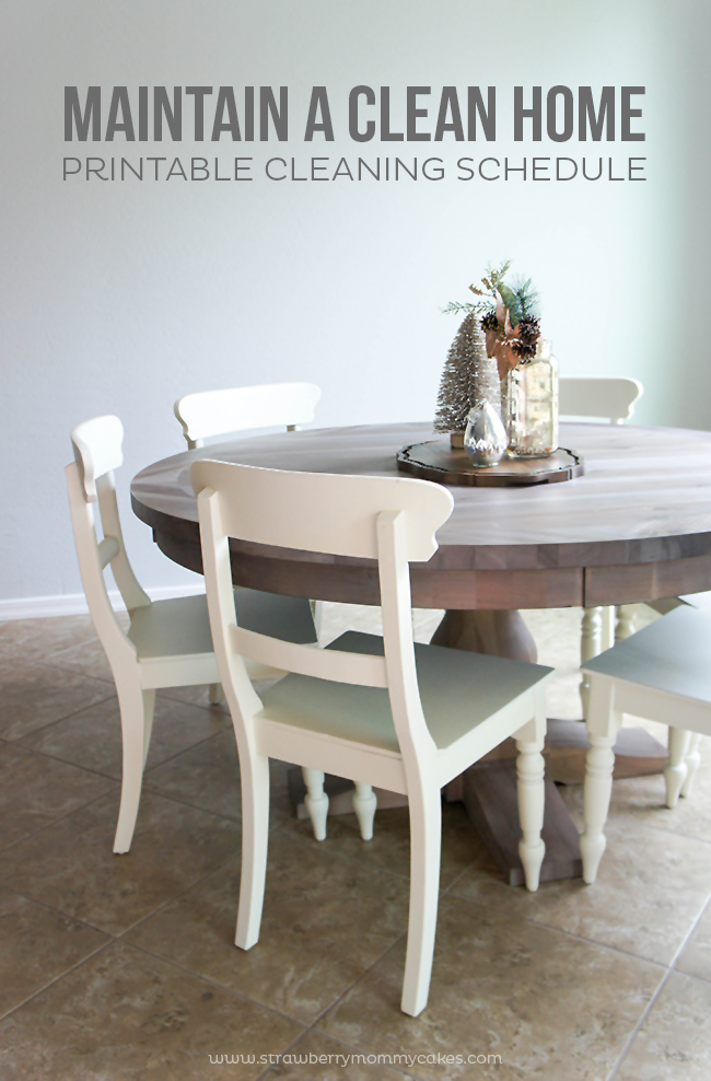 White dining room chairs and round wood table