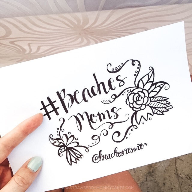 Hand-lettered notecard that reads #beachesmoms