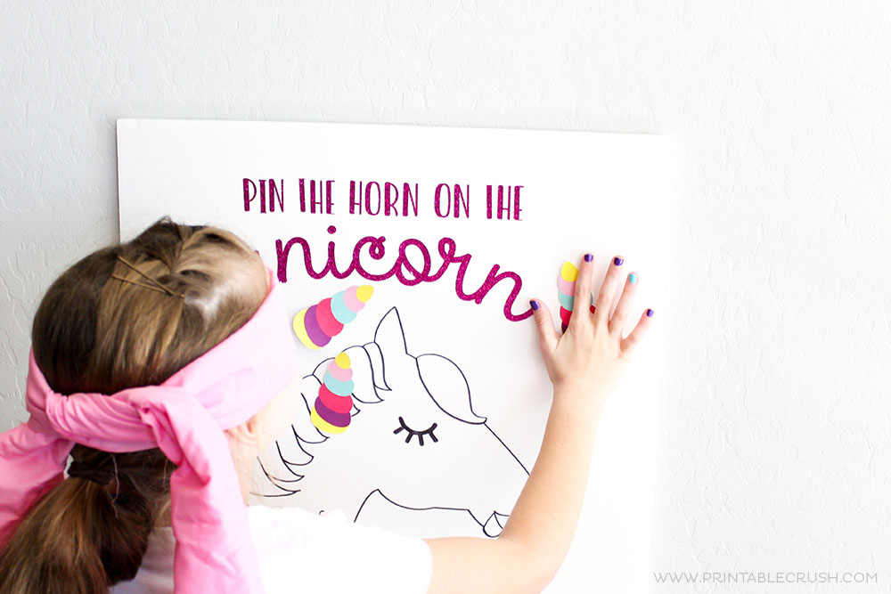 See this tutorial and download the FREE Cricut Cut Files for this Pin the Horn on the Unicorn Party Game. This new take on a classic game is a huge hit!
