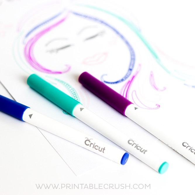 Teal and purple Cricut machine pens