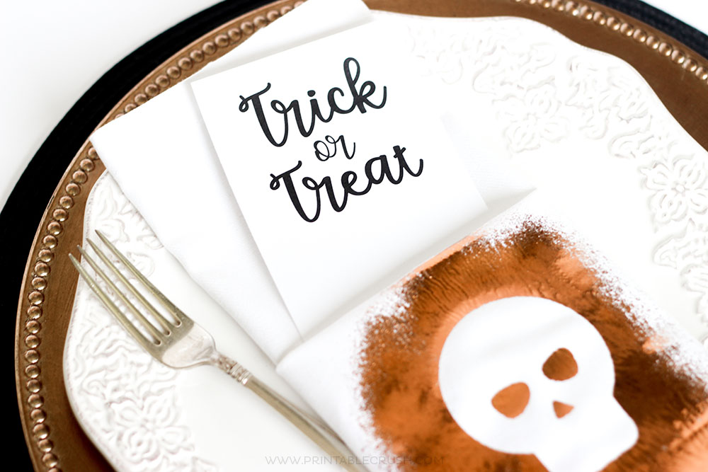 Create these GORGEOUS Foil Halloween Napkins using Thermoweb Spray Adhesive and a free SVG Cut File! They'll look amazing for your Halloween table decor.