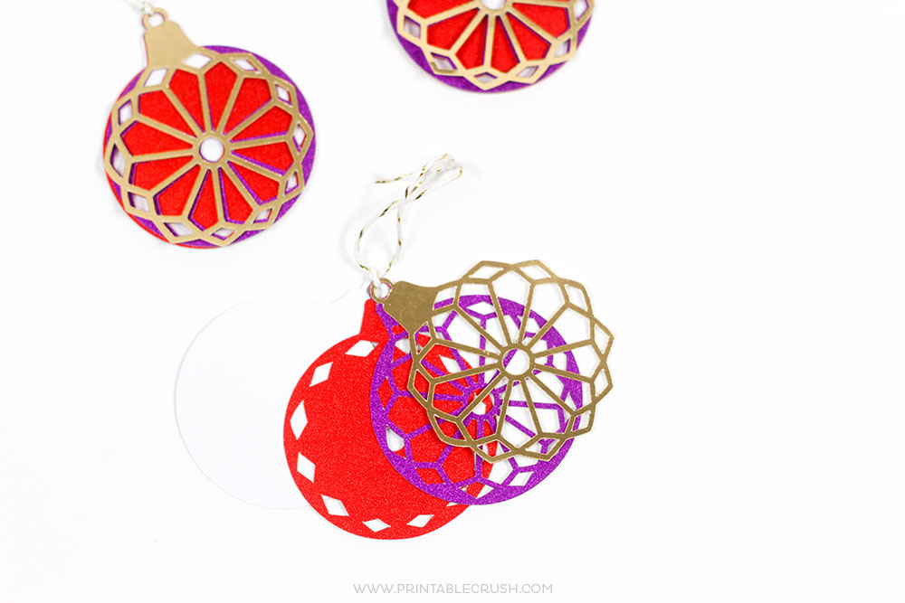 Use these Handmade Cricut Christmas Gift Decorating Ideas to wrap a perfectly beautiful present! These can also double as Christmas Ornaments!