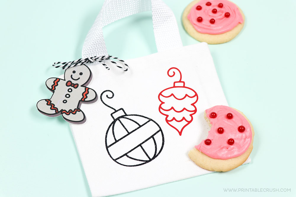 Use different Christmas SVG Files to create some Holiday Baking Christmas Gifts - like these really cute Christmas Cookie Bags!