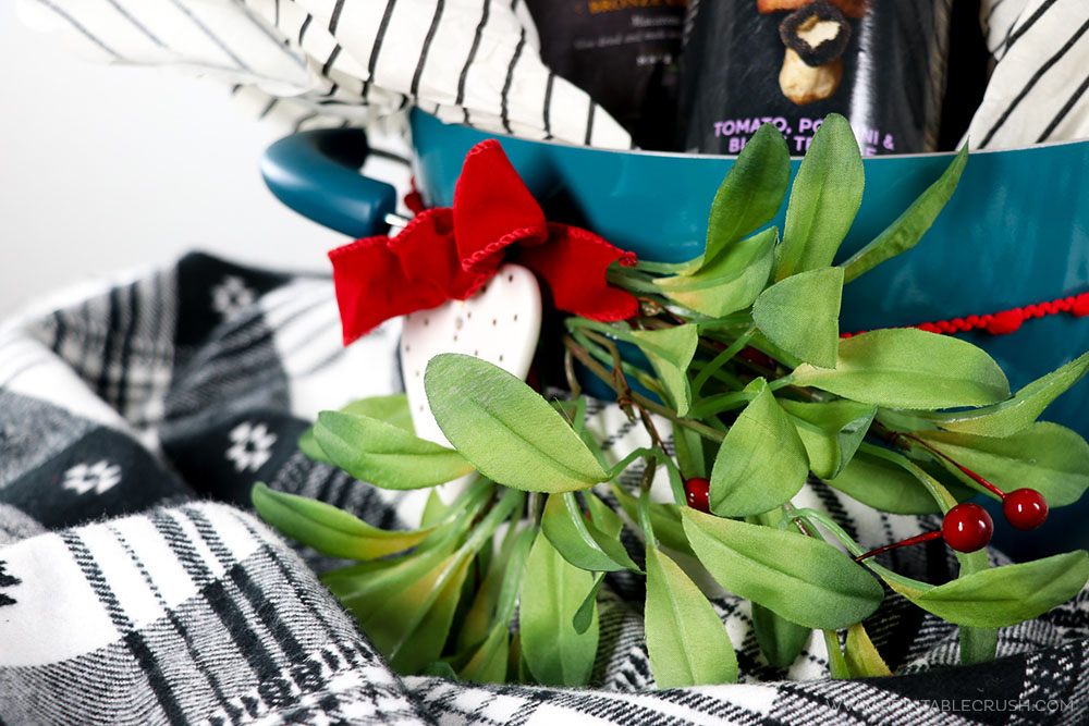 Add some mistletoe to this newlywed Christmas Gift Basket for the perfect touch!