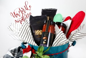 Fill a pot with cooking utensils, recipe cards, and Signature RESERVE™ pasta and canned red sauce to create this cute Newlywed Christmas Gift Basket Idea!