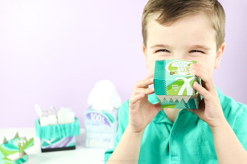 Kids love these cute Dinosaur Masks made from empty Kleenex Tissue Boxes - go ahead and try out this craft for Earth Day!