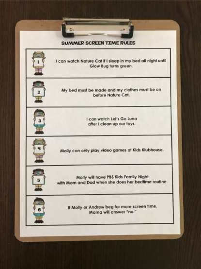 summer screen time rules printable on clipboard on brown table