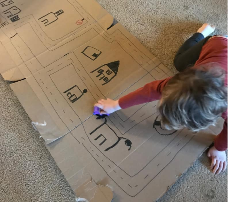 toddler-playing-on-box-road-easiest-way-to-improve-childs-behavior