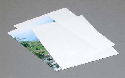 Few sheets of Archival paper with a print in between