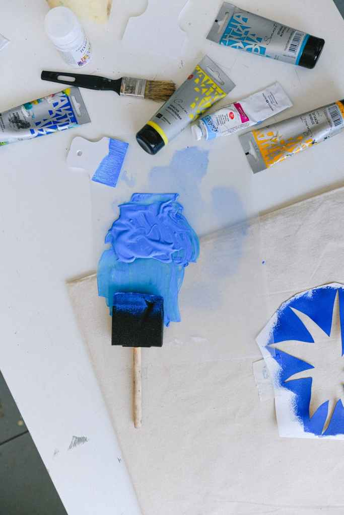 paintbrush and tubes with paint on table