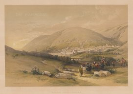 Nablous, Ancient Shechem: Panorama of the city with evening camel train and ruins in foreground.