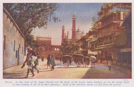 Delhi: View of the Jama Masjid minarets and gate 1 from the street. With text.