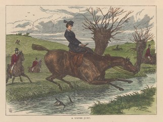 Taking a water jump side-saddle.
