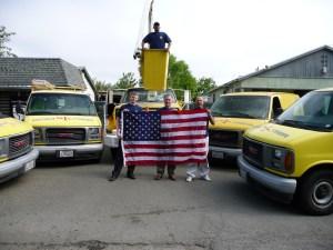 Trucks, technicians, and US flag