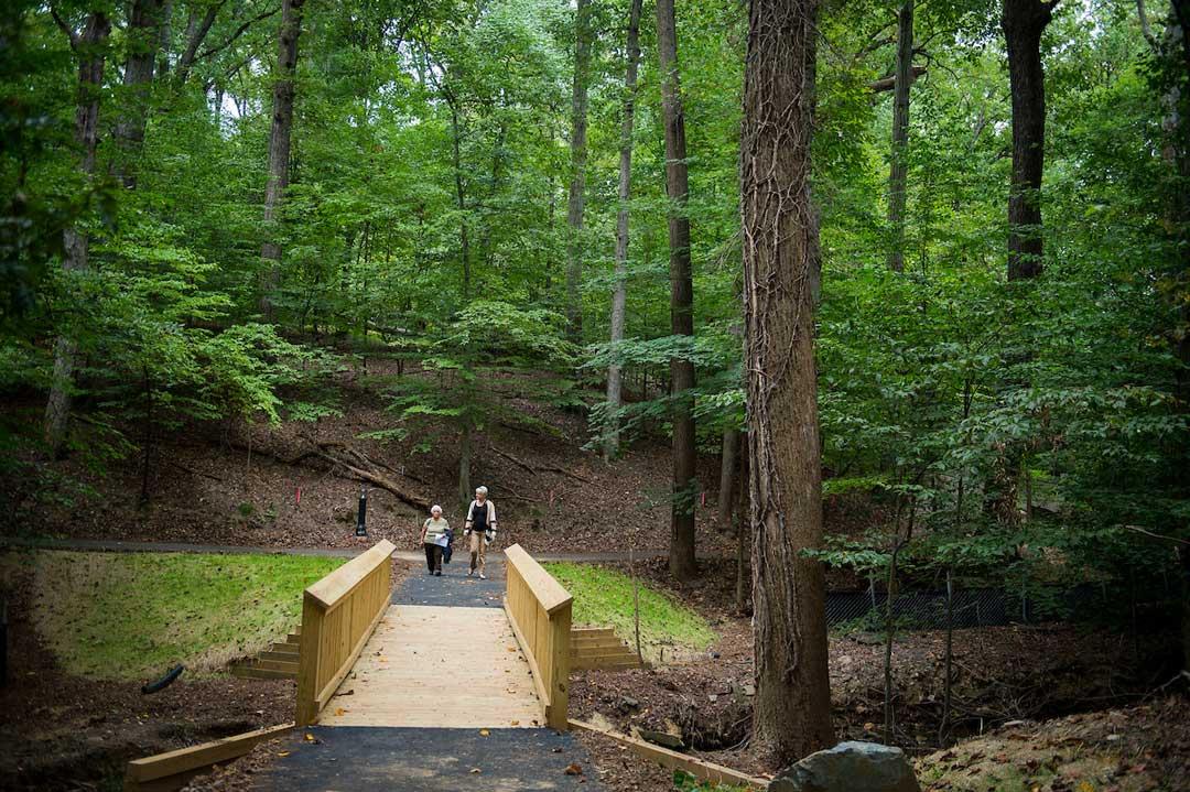 – A timber pedestrian bridge crossing Stoney Creek serves as the portal into The Green Road. Photo: Lisa Helfert