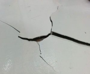 Photo of cracking in epoxy cement substrate